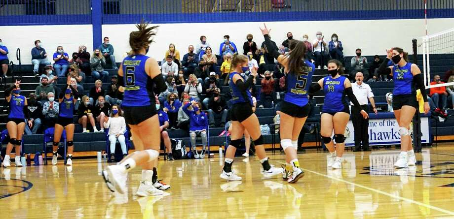 Morley Stanwood's volleyball team celebrates a point during its sweep of White Cloud at home on Wednesday evening. (Pioneer photo/Joe Judd)