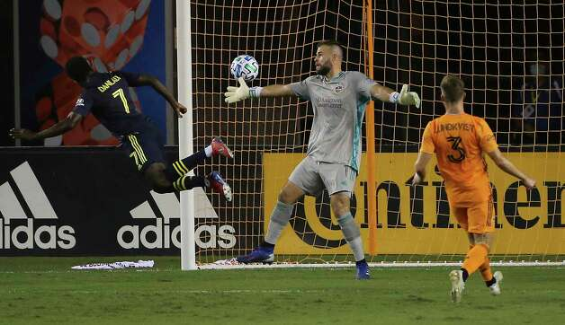Nashville SC forward Abu Danladi (7) scores a goal on Houston Dynamo with a header at the 19th minute during the first half of a MLS game Wednesday, Oct. 14, 2020, at BBVA Stadium in Houston. Photo: Yi-Chin Lee, Staff Photographer / © 2020 Houston Chronicle