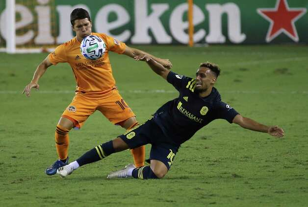 Houston Dynamo midfielder Tomás Martínez (10) fouls on Nashville SC midfielder Hany Mukhtar (10) during the first half of a MLS game Wednesday, Oct. 14, 2020, at BBVA Stadium in Houston. Photo: Yi-Chin Lee, Staff Photographer / © 2020 Houston Chronicle