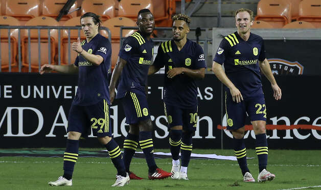 Nashville SC players celebrate midfielder Hany Mukhtar's (10) goal at the 15th minute during the first half of a MLS game against the Houston Dynamo Wednesday, Oct. 14, 2020, at BBVA Stadium in Houston. Photo: Yi-Chin Lee, Staff Photographer / © 2020 Houston Chronicle