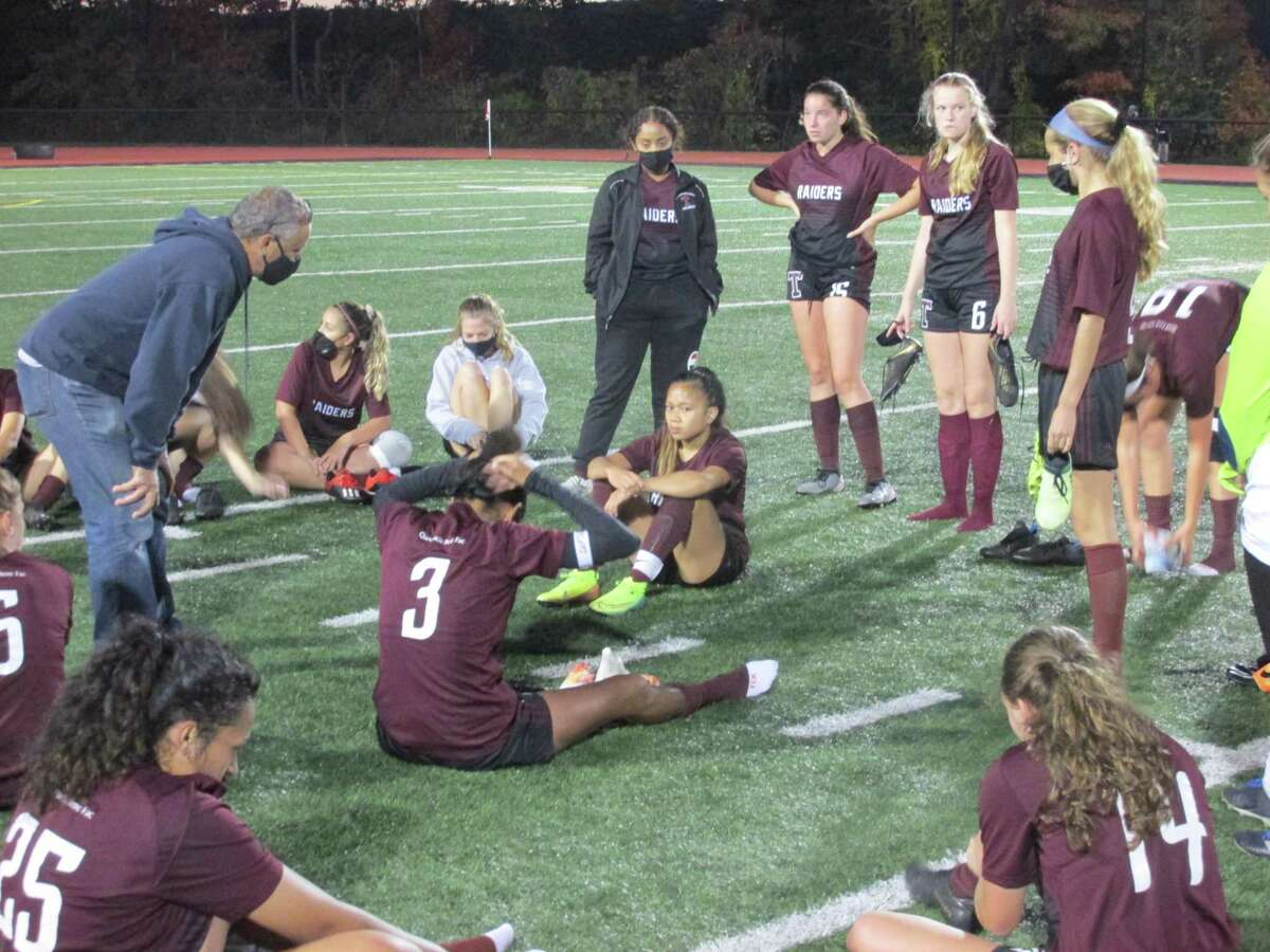 Torrington girls soccer coach Mario Longobuxxo talks to his team after a loss to Wolcott Wednesday evening at the Robert H. Frost Sports Complex.