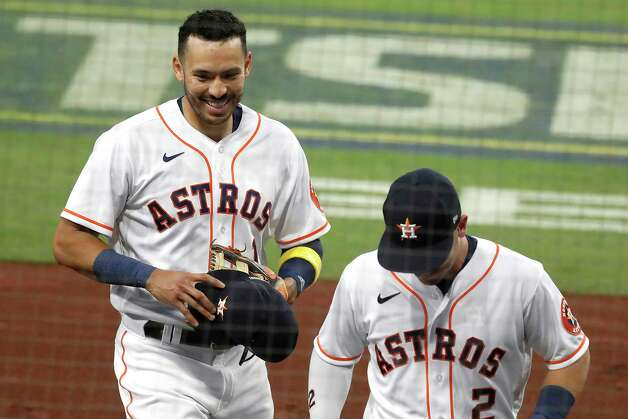 Houston Astros Carlos Correa (1) and Alex Bregman (2) leave the field after getting out of the third inning of Game 4 of the American League Championship Series against the Tampa Bay Rays at Petco Park Wednesday, Oct. 14, 2020, in San Diego. Photo: Karen Warren, Staff Photographer / © 2020 Houston Chronicle