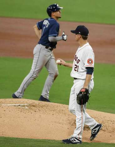 Houston Astros Zack Greinke (21) walks back to the mound as Tampa Bay Rays Willy Adames (1) jogs back to the dugout after he was doubled up on a grounder by Yoshi Tsutsugo during the third inning of Game 4 of the American League Championship Series at Petco Park Wednesday, Oct. 14, 2020, in San Diego. Photo: Karen Warren, Staff Photographer / © 2020 Houston Chronicle