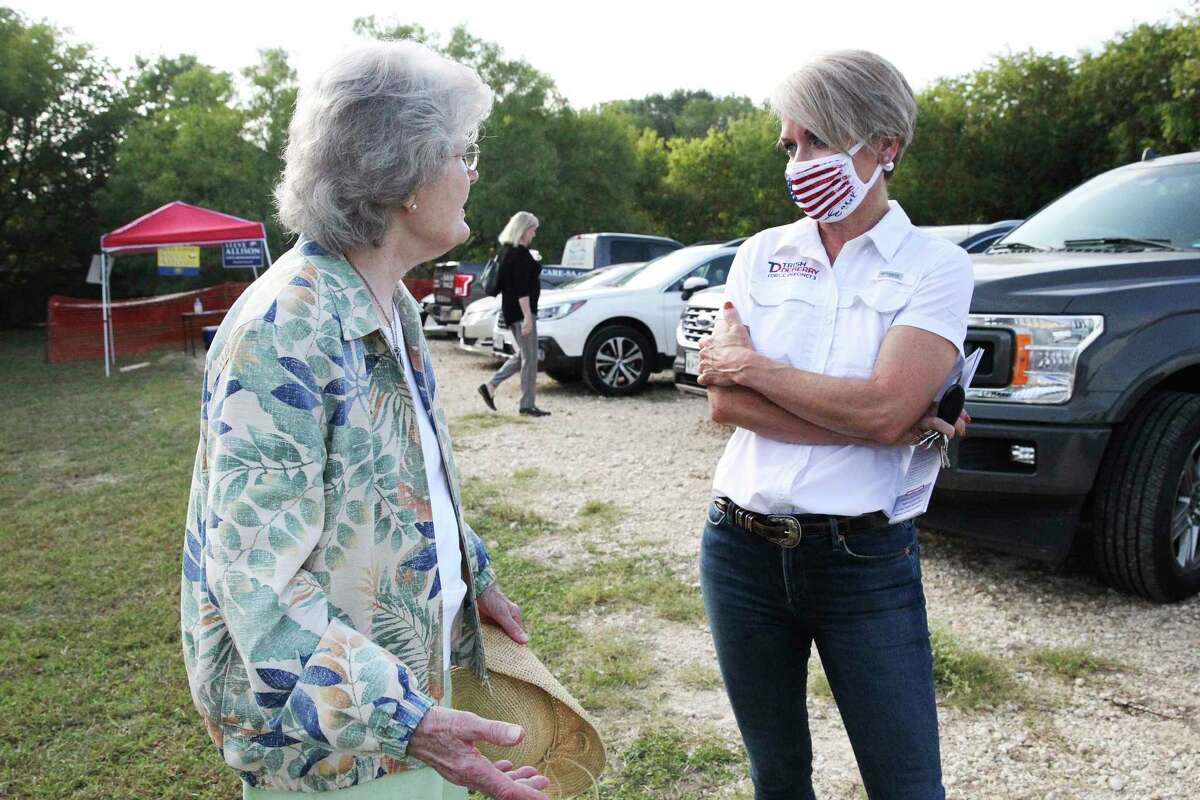 Precinct 3 Commissioners Court Republican candidate Trish DeBerry chats with Harriot Nelson as she greets supporters and others visiting the polls at Brookhollow Library.