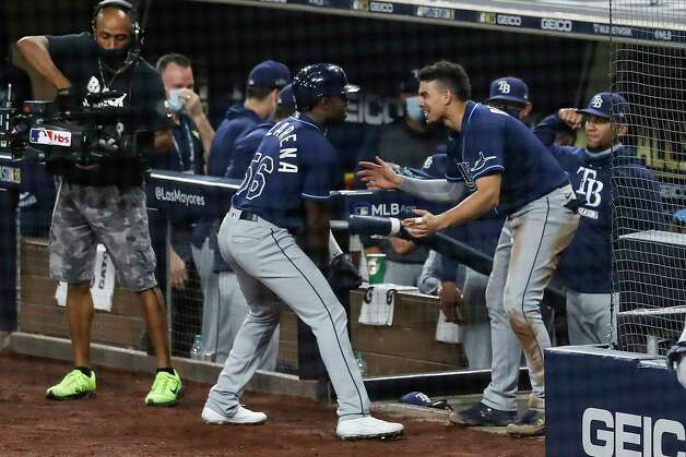 Tampa Bay Rays Randy Arozarena (56) is met at the dugout by Willy Adames after Arozarena hit a 2-run home run off Houston Astros starter Zack Greinke during the fourth inning of Game 4 of the American League Championship Series at Petco Park Wednesday, Oct. 14, 2020, in San Diego. Photo: Karen Warren, Staff Photographer / © 2020 Houston Chronicle