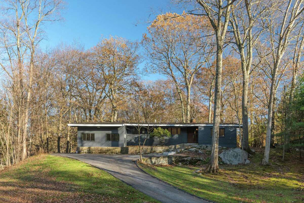 Built in the mid-1960s, the Mid-Century modern home at 34 Montgomery Lane, Greenwich, is listed for sale. Sotheby's International Realty's Steve Kane is the listing agent for the property, with an asking price of $1.575 million.