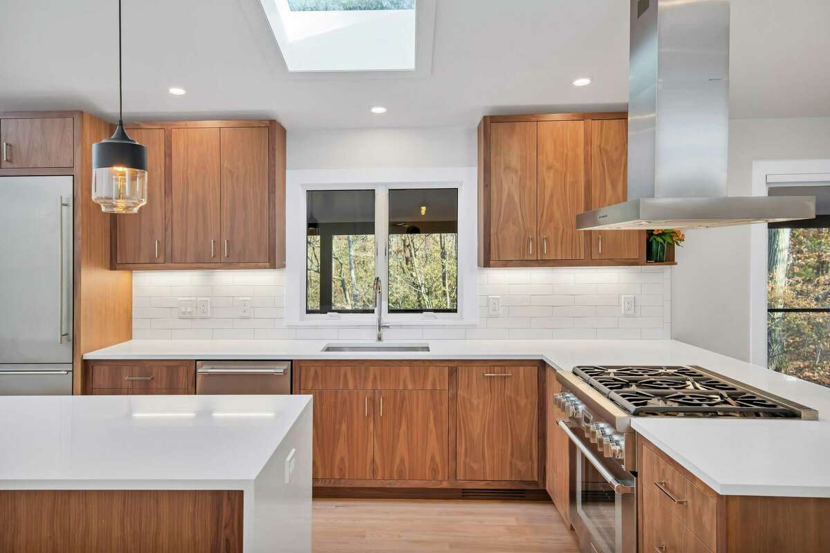 The kitchen at 34 Montgomery Lane has been updated, in a design aesthetic that's cohesive with the Mid-Century character of the home.