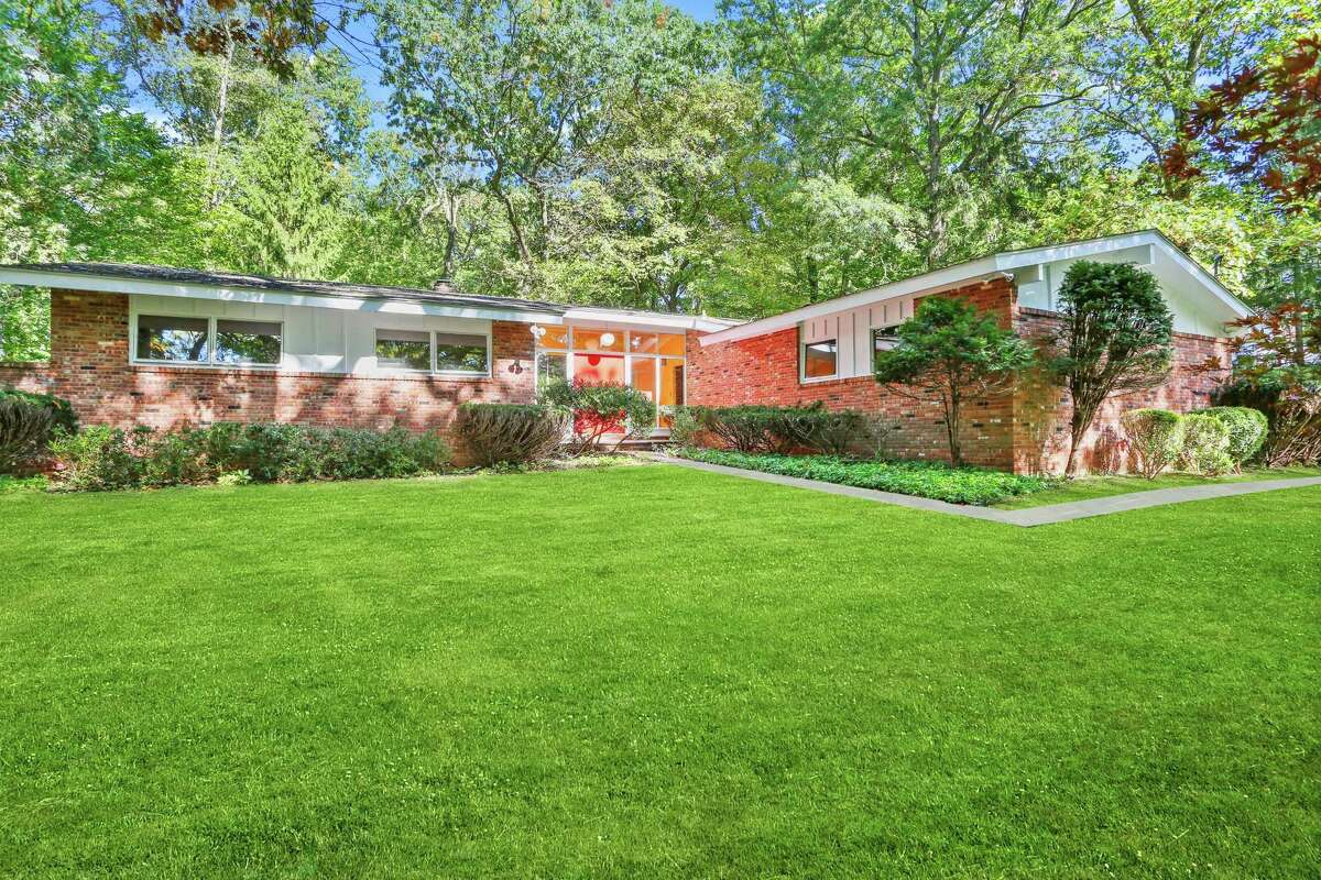 Built in 1960, the Mid-Century modern home at 261 Cognewaugh Road, Cos Cob, is listed for sale, with an asking price of $1.125 million. Houlihan Lawrence's Barbara Wells is the listing agent.