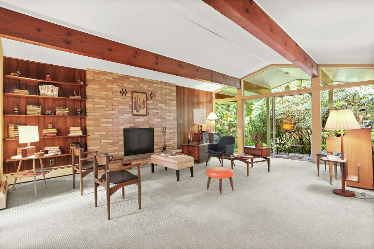 True to form, the Mid-Century home at 261 Cognewaugh was created using a blend of brick, stone, wood and glass.