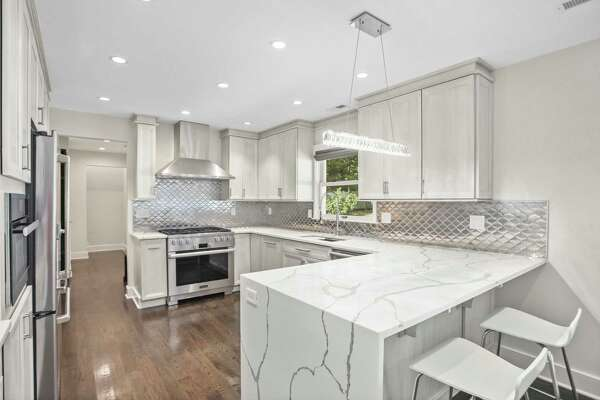 "The kitchen was designed to ""maximize functionality,"" according to the seller, who selected Miele appliances and Calacatta Gold surfaces for the remodel."