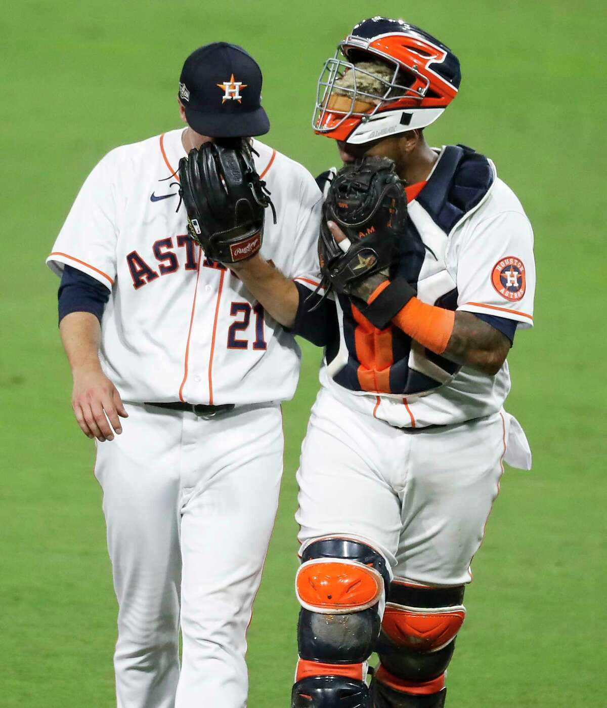 Houston Astros starter Zack Greinke (21) and catcher Martin Maldonado (15) walk off the field at the end of the fourth inning after giving up a pair of runs in Game 4 of the American League Championship Series at Petco Park Wednesday, Oct. 14, 2020, in San Diego.
