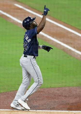 Tampa Bay Rays Randy Arozarena (56) points to the sky as he rounds the bases after hitting a 2-run home run off Houston Astros Zack Greinke during the fourth inning of Game 4 of the American League Championship Series at Petco Park Wednesday, Oct. 14, 2020, in San Diego. Photo: Karen Warren, Staff Photographer / © 2020 Houston Chronicle