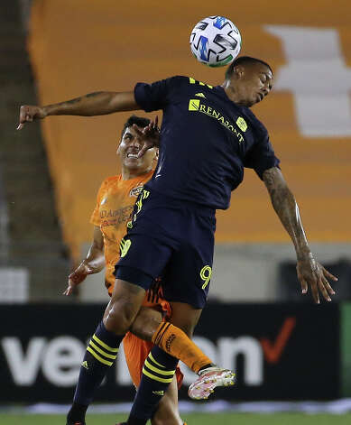 Nashville SC forward Jhonder Cadiz (99) gets a header over Houston Dynamo defender Jose Bizama (18) during the second half of a MLS game Wednesday, Oct. 14, 2020, at BBVA Stadium in Houston. Houston Dynamo lost to Nashville SC 3-1. Photo: Yi-Chin Lee, Staff Photographer / © 2020 Houston Chronicle