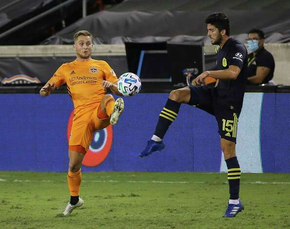 Houston Dynamo defender Adam Lundqvist (3) and Nashville SC defender Eric Miller (15) try to get control of the ball during the second half of a MLS game Wednesday, Oct. 14, 2020, at BBVA Stadium in Houston. Houston Dynamo lost to Nashville SC 3-1. Photo: Yi-Chin Lee, Staff Photographer / © 2020 Houston Chronicle