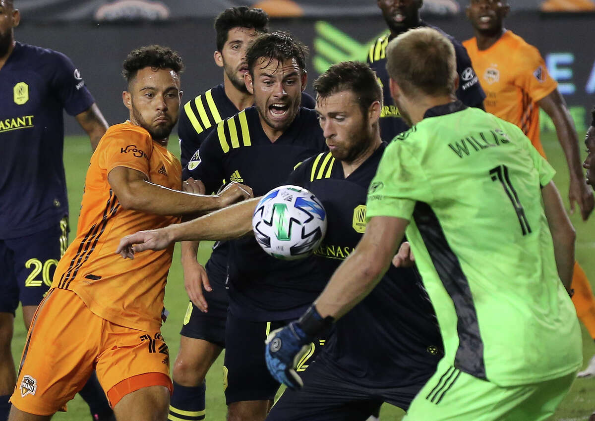 Houston Dynamo forward Niko Hansen (12) tries to score a goal with a corner kick while surrounded by Nashville SC players during the second half of a MLS game Wednesday, Oct. 14, 2020, at BBVA Stadium in Houston. Houston Dynamo lost to Nashville SC 3-1.