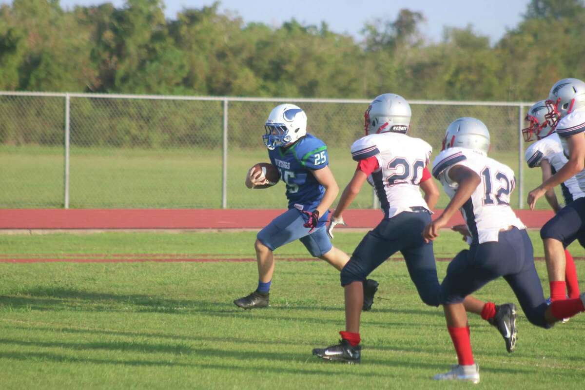 Fairmont Junior High's Diego Cuza scores another Vikings touchdown Wednesday. He scored all 16 points in the second half.