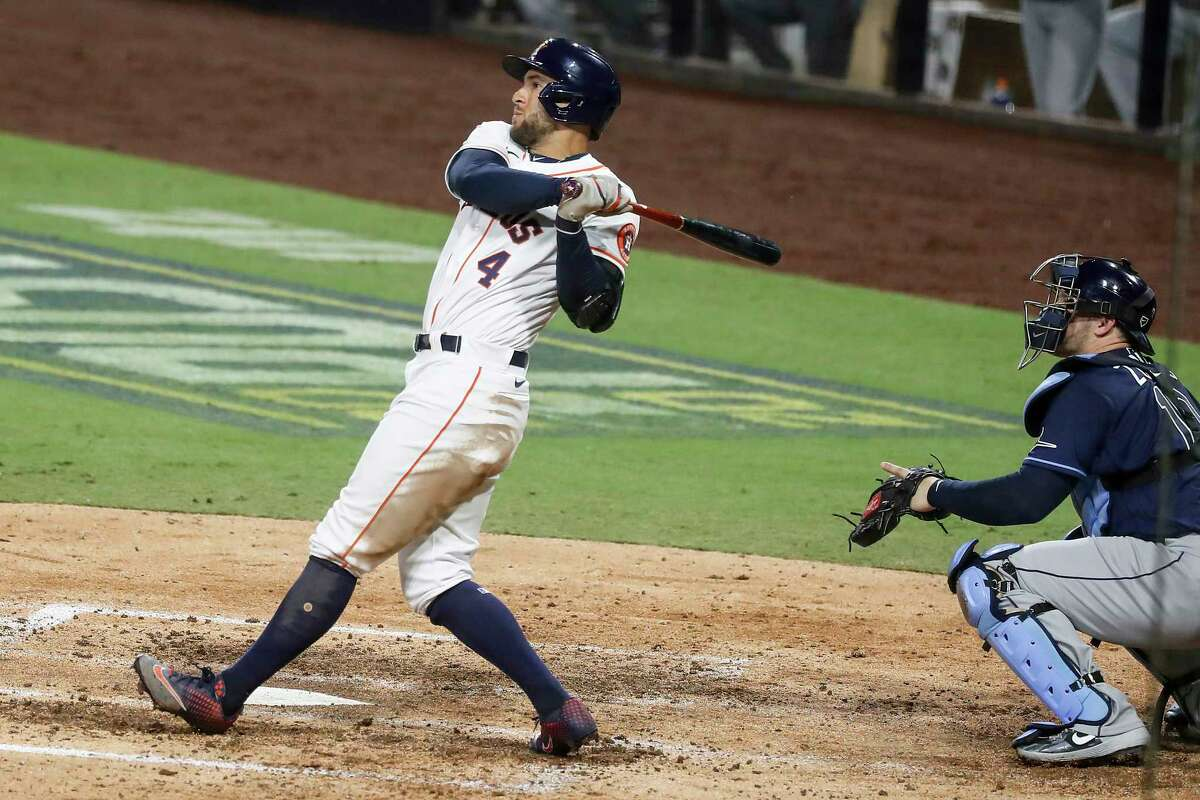 Houston Astros George Springer hits a 2-run home run off Tampa Bay Rays Tyler Glasnow during the fifth inning of Game 4 of the American League Championship Series at Petco Park Wednesday, Oct. 14, 2020, in San Diego.