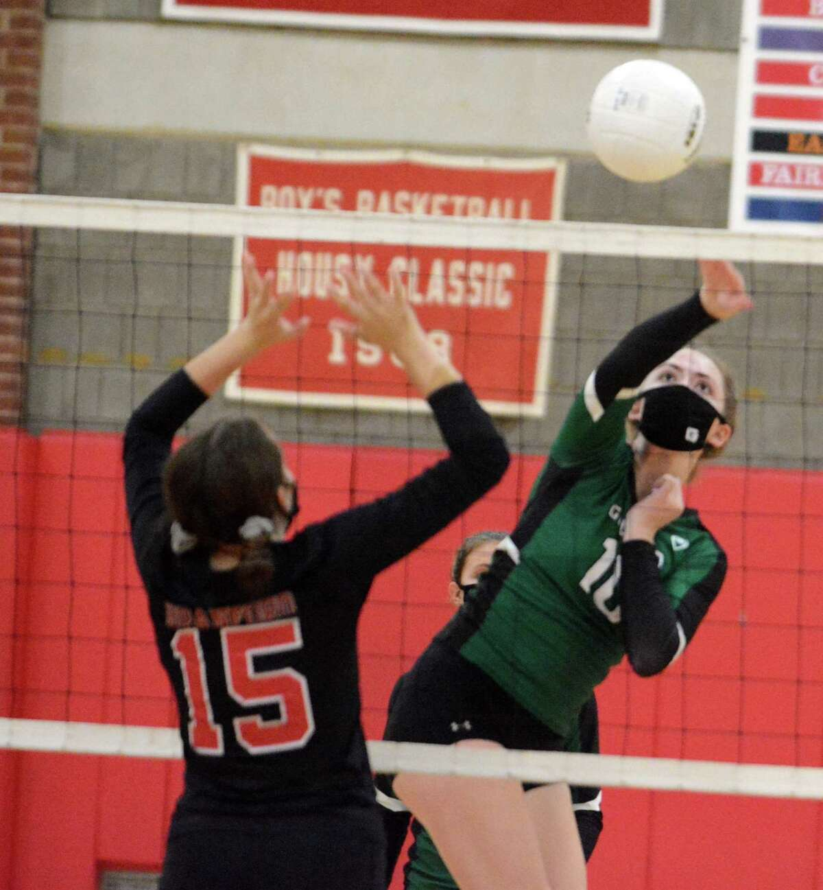Guilford's Emily Brouder spikes the ball past Branford's Breanna Botte during a girls volleyball match at Branford on Tuesday, Oct. 14, 2020 in Branford, Conn.