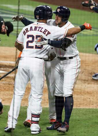 Houston Astros George Springer embraces Michael Brantley (23) after Springer hit a 2-run home run off Tampa Bay Rays Tyler Glasnow during the fifth inning of Game 4 of the American League Championship Series at Petco Park Wednesday, Oct. 14, 2020, in San Diego. Photo: Karen Warren, Staff Photographer / © 2020 Houston Chronicle