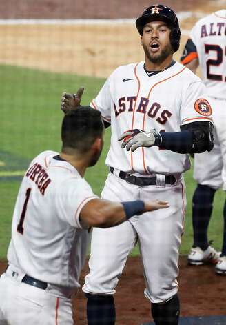 Houston Astros George Springer and Carlos Correa (1) celebrate after Springer hit a 2-run home run off Tampa Bay Rays Tyler Glasnow during the fifth inning of Game 4 of the American League Championship Series at Petco Park Wednesday, Oct. 14, 2020, in San Diego. Photo: Karen Warren, Staff Photographer / © 2020 Houston Chronicle