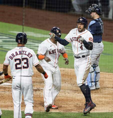 Houston Astros George Springer celebrates with Michael Brantley (23) and Martin Maldonado (15) after hitting a 2-run home run off Tampa Bay Rays Tyler Glasnow during the fifth inning of Game 4 of the American League Championship Series at Petco Park Wednesday, Oct. 14, 2020, in San Diego. Photo: Karen Warren, Staff Photographer / © 2020 Houston Chronicle