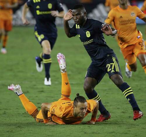 Houston Dynamo defender Sam Junqua (29) falls to the ground while Nashville SC Tah Anunga is defensing during the second half of a MLS game Wednesday, Oct. 14, 2020, at BBVA Stadium in Houston. Houston Dynamo lost to Nashville SC 3-1. Photo: Yi-Chin Lee, Staff Photographer / © 2020 Houston Chronicle