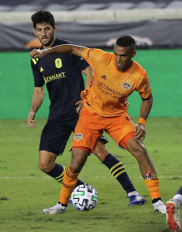 Houston Dynamo forward Mauro Manotas (9) is defensed by Nashville SC defender Eric Miller (15) during the second half of a MLS game Wednesday, Oct. 14, 2020, at BBVA Stadium in Houston. Houston Dynamo lost to Nashville SC 3-1. Photo: Yi-Chin Lee, Staff Photographer / © 2020 Houston Chronicle