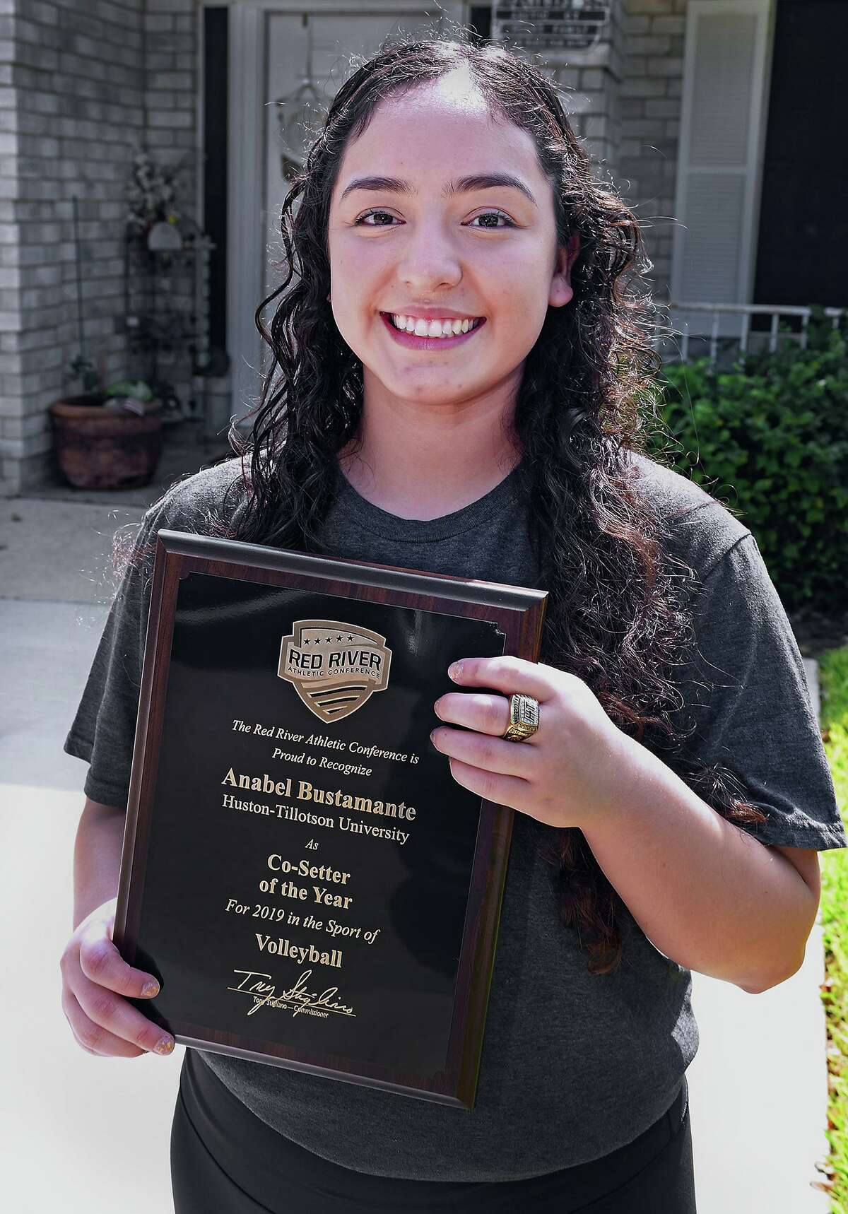 Former United High School volleyball player Anabel Bustamante shows the plaque and ring she won as a member of the Huston-Tillotson University volleyball team which won the Red River Conference in 2019. Bustamante was recognized as Co-Setter of the Year.