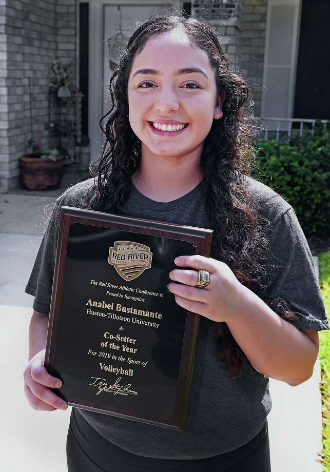 Former United High School volleyball player Anabel Bustamante shows the plaque and ring she won as a member of the Huston-Tillotson University volleyball team which won the Red River Conference in 2019. Bustamante was recognized as Co-Setter of the Year. Photo: Cuate Santos /Laredo Morning Times / Laredo Morning Times