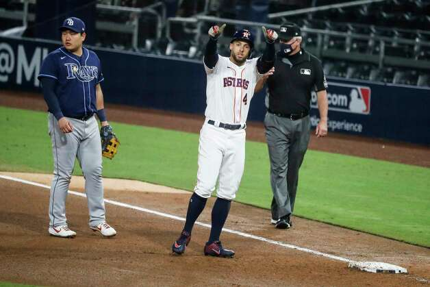 Houston Astros George Springer (4) gives a thumbs up to the dugout after hitting a single off Tampa Bay Rays reliever Jose Alvarado during the seventh inning of Game 4 of the American League Championship Series at Petco Park Wednesday, Oct. 14, 2020, in San Diego. Photo: Karen Warren, Staff Photographer / © 2020 Houston Chronicle