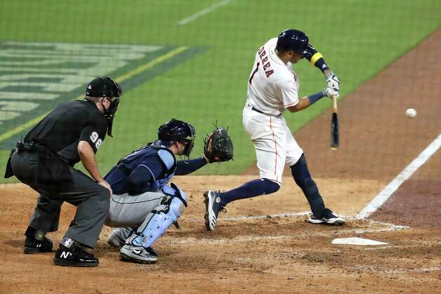 Houston Astros Carlos Correa (1) hits into a double play against the Tampa Bay Rays to end the eighth inning of Game 4 of the American League Championship Series at Petco Park Wednesday, Oct. 14, 2020, in San Diego. Photo: Karen Warren, Staff Photographer / © 2020 Houston Chronicle
