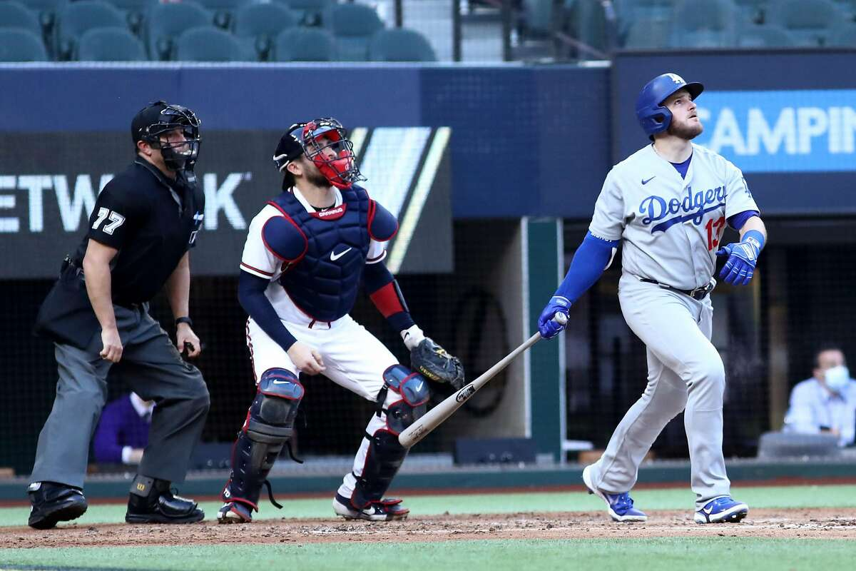 The Dodgers' Max Muncy follows the flight of his grand slam, with capped an 11-run first-inning outburst against the Braves.