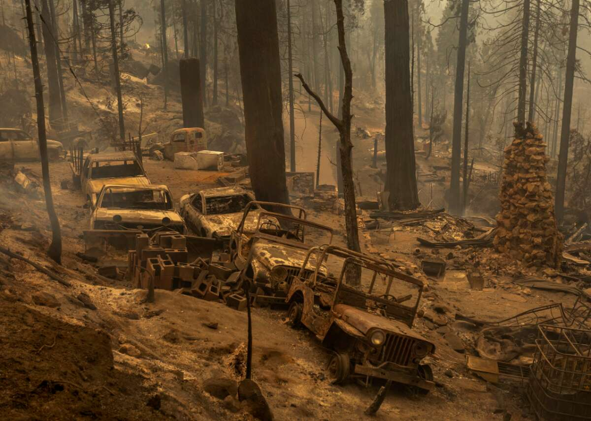A community of forest homes lies in ruins along Auberry Road near Shaver Lake, Calif., after the Creek Fire swept through on Sept. 8, 2020.