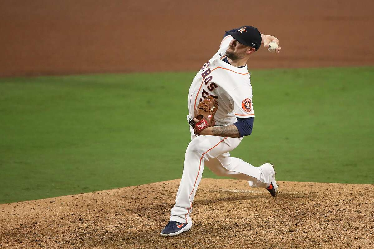 SAN DIEGO, CALIFORNIA - OCTOBER 14: Ryan Pressly #55 of the Houston Astros pitches against the Tampa Bay Rays during the ninth inning in Game Four of the American League Championship Series at PETCO Park on October 14, 2020, in San Diego.