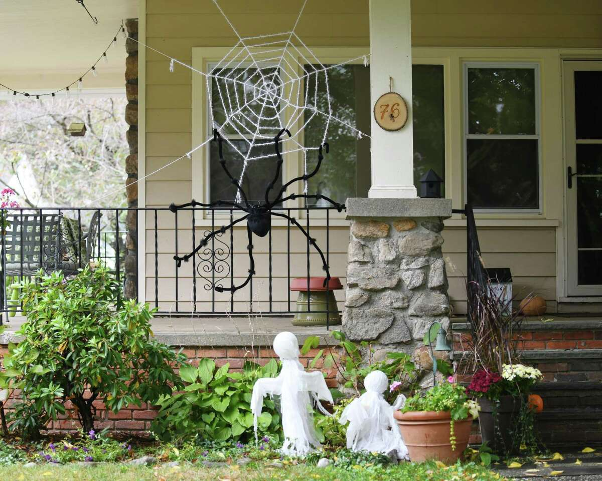 Homes are decorated with spooky Halloween decorations in the Hubbard Heights neighborhood of Stamford on Monday.