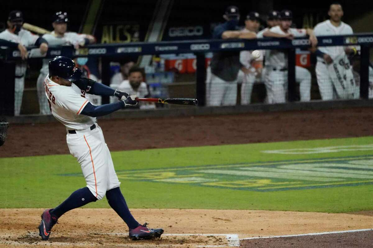 The Houston Astros' George Springer hits a 2-run home run against the Tampa Bay Rays during the fifth inning in Game 4 of the American League Championship Series on Wednesday.