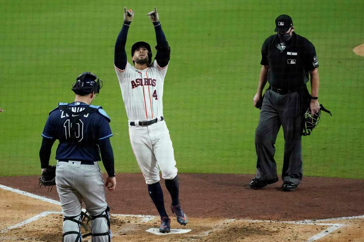 Tampa Bay Rays catcher Mike Zunino watches as the Houston Astros' George Springer celebrates his 2-run home run against the Tampa Bay Rays during the fifth inning in Game 4 of the American League Championship Series on Wednesday.