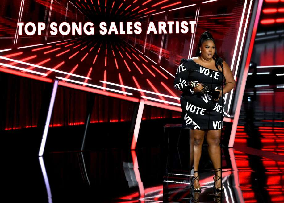 HOLLYWOOD, CALIFORNIA - OCTOBER 14: In this image released on October 14, Lizzo accepts the Top Song Sales Artist Award onstage at the 2020 Billboard Music Awards, broadcast on October 14, 2020 at the Dolby Theatre in Los Angeles, CA. (Photo by Kevin Winter/BBMA2020/Getty Images for dcp) Photo: Kevin Winter/BBMA2020/Getty Images For Dcp / 2020 DCP Rights LLC and Getty Images