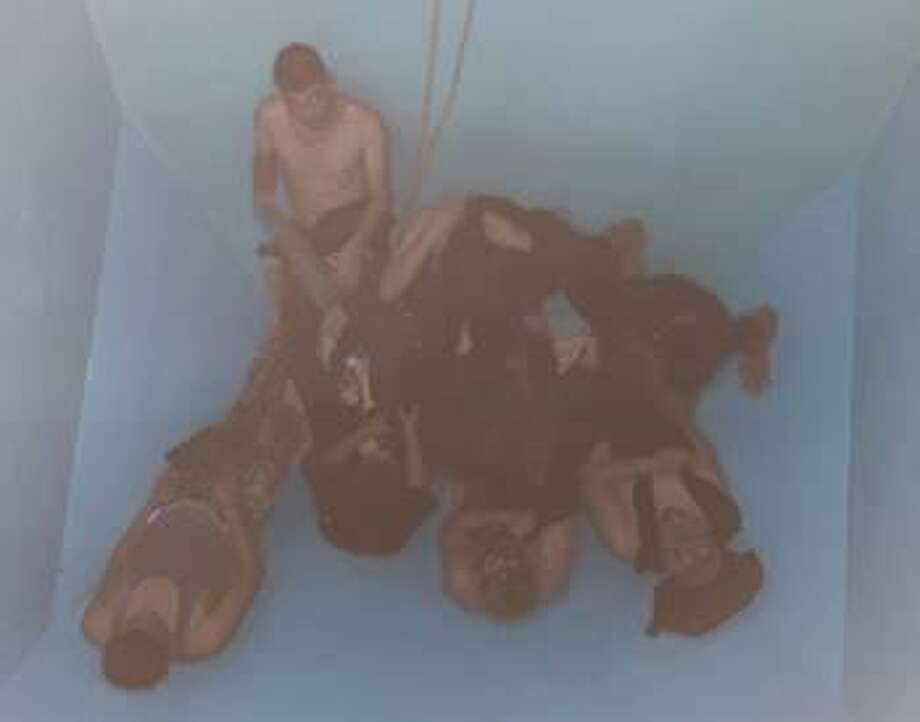 U.S. Border Patrol agents found this group of immigrants inside a grain hopper train car. Authorities said the immigrants had no means of escape. Photo: Courtesy Photo /U.S. Border Patrol