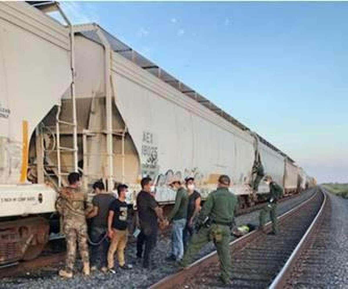 U.S. Border Patrol agents discovered 11 immigrants inside a grain hopper train car. Authorities said the immigrants had no means of escape.