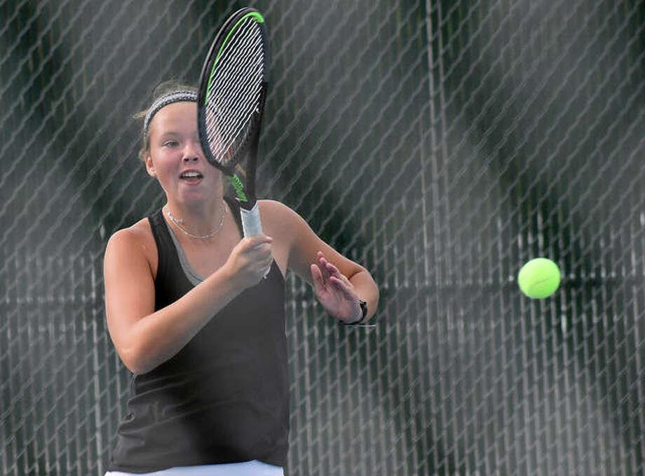 Edwardsville's Morgan Marshall hits a return shot during her singles match at the Southwestern Conference Tournament at Roxana. Photo: Matt Kamp|The Intelligencer