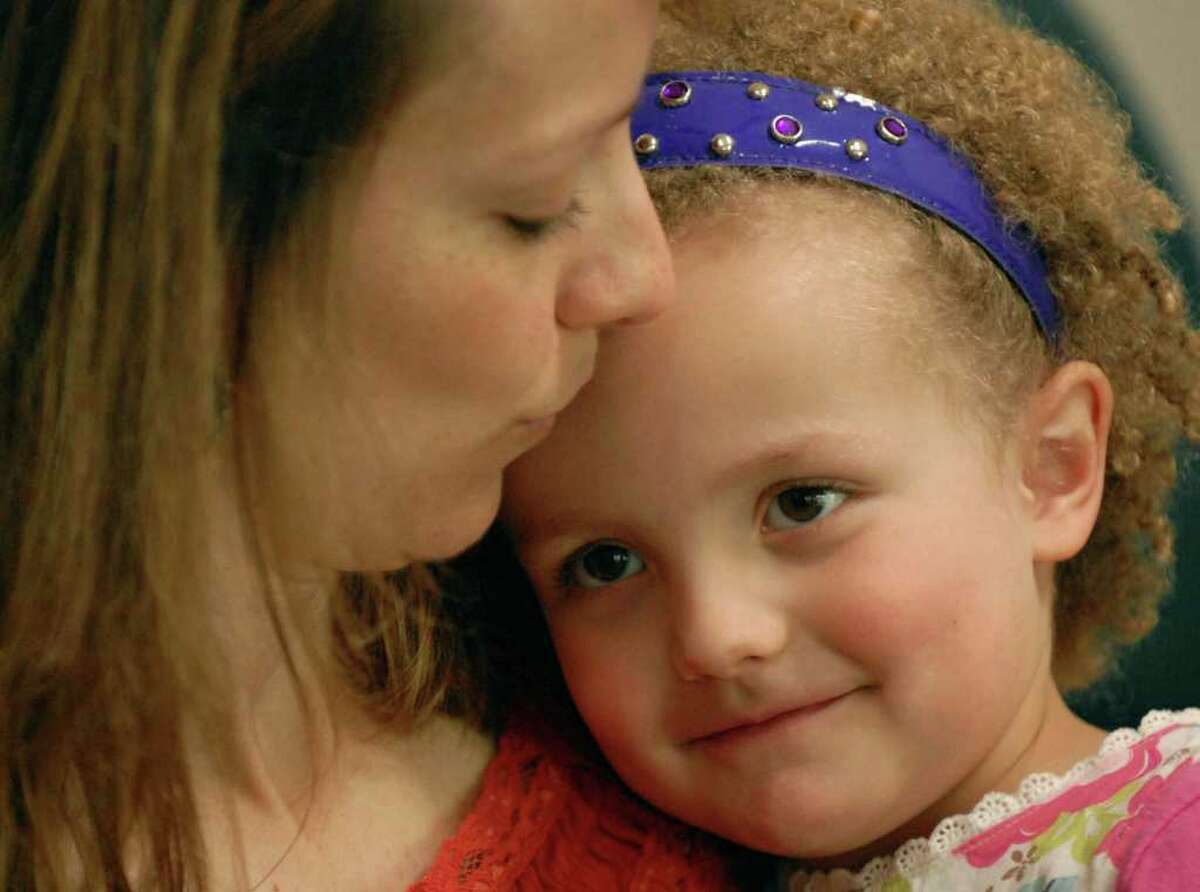 Times Union Staff Photo -- Michael P.Farrell -- Rexford , New York -- 5/21/2008 -- A happy four-year-old Hannah Sames gets a kiss from her mother Lori Sames in their Rexford home. Hannah suffers from a rare genetic disorder. ( w/ Crowley story)