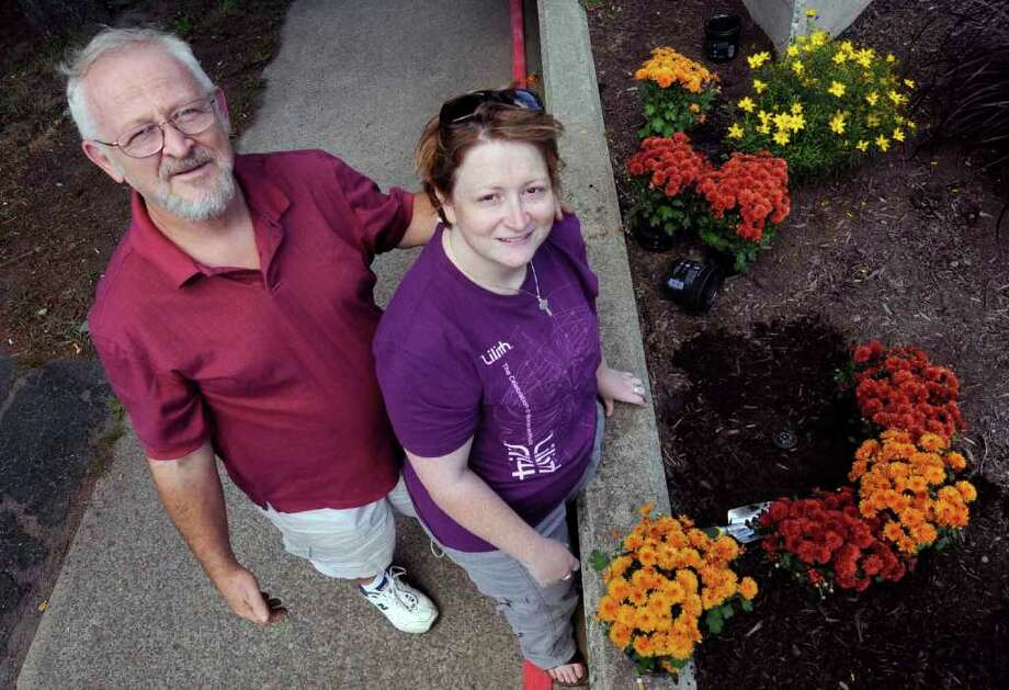 Theresa Thibodeau and her father, Patrick Thibodeau, joined Cohoes' Adopt-A-Park Program this year. They adopted Canal Square where concerts are held. They cleaned up the park and planted flowers. They maintain it for the city .8/28/2010. ( Michael P. Farrell / Times Union ) Photo: Michael P. Farrell