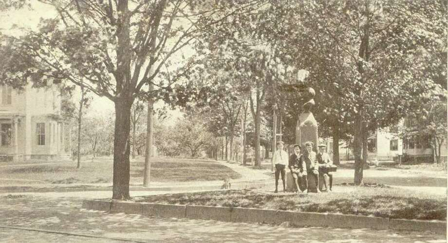 This postcard from 1906 shows four young fellows waiting by the Garfield Monument in Danbury. The postcard is from the collection of George H. Franklin of Brookfield. Photo: Contributed Photo / The News-Times Contributed