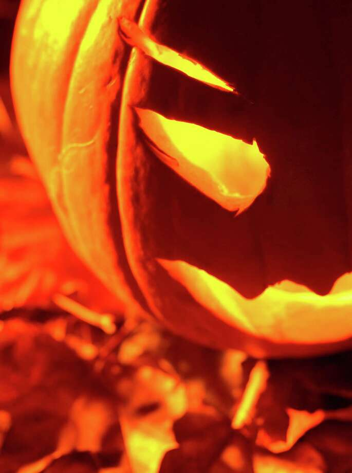 "More than 500 pumpkins will be turned into jack-o'-lanterns to light the way on a spooky outdoor trail at Mystic Seaport Museum, Oct. 26-30. The spectacle will be part of a new attraction called the ""Jack-o'-Lantern Walk,"" which also includes games, music, a campfire and more. The festivities conclude with a costume parade on Halloween. Photo: Hemera Technologies / Contributed Photo / Getty Images / (c) Hemera Technologies"