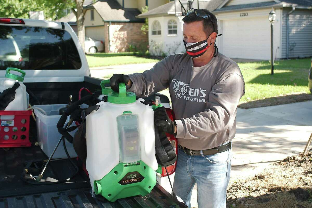 Blake Smaistrla. owner of Ben's Pest Control, prepares to treat a customer's home in Pearland. Increased demand for services at homes in northern Brazoria County and the Bay Area started in April and hasn't abated.