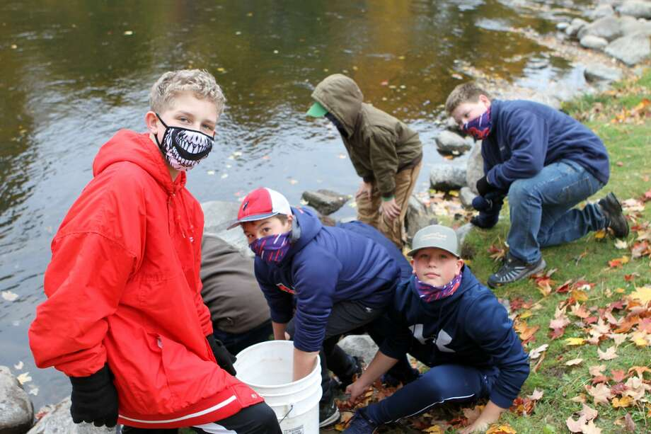 A portion of the Muskegon River was restocked Thursday morning with help from a group of Big Rapids Middle School students. Photo: Pioneer Photo/Bradley Massman