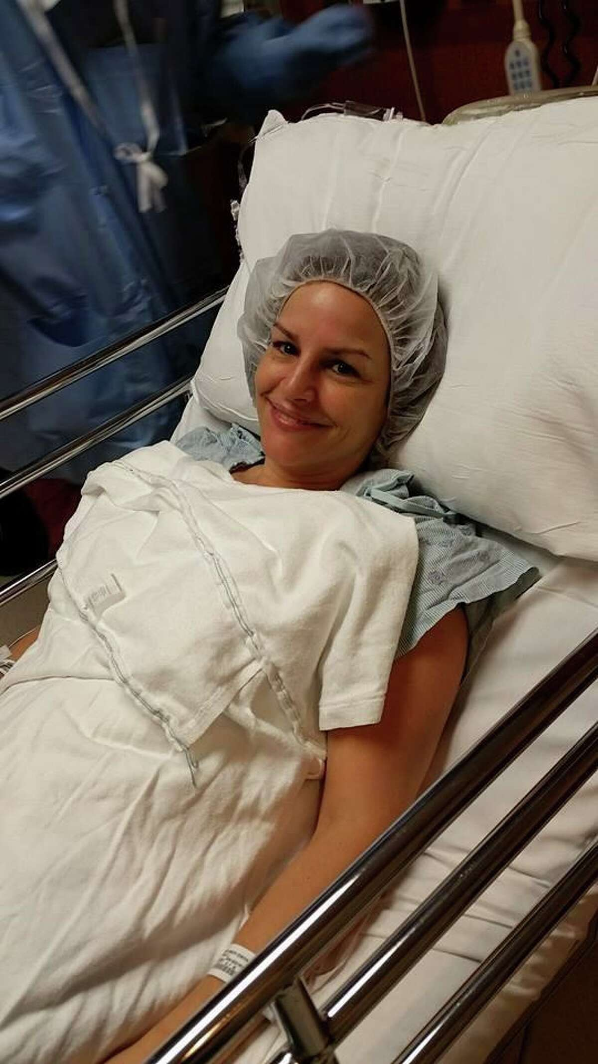 Michelle Perzan prepares for surgery for breast cancer in 2015.