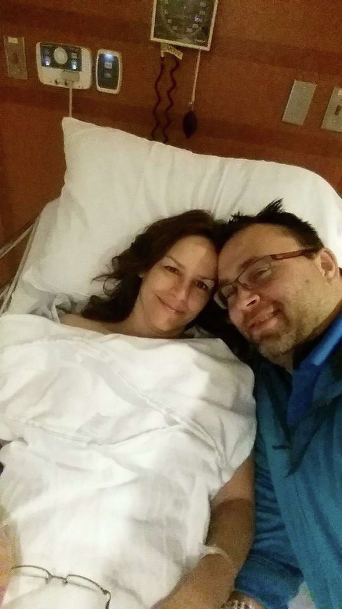 Michelle Perzan shares a moment with her husband, Aaron, as she recovers from surgery in 2015.