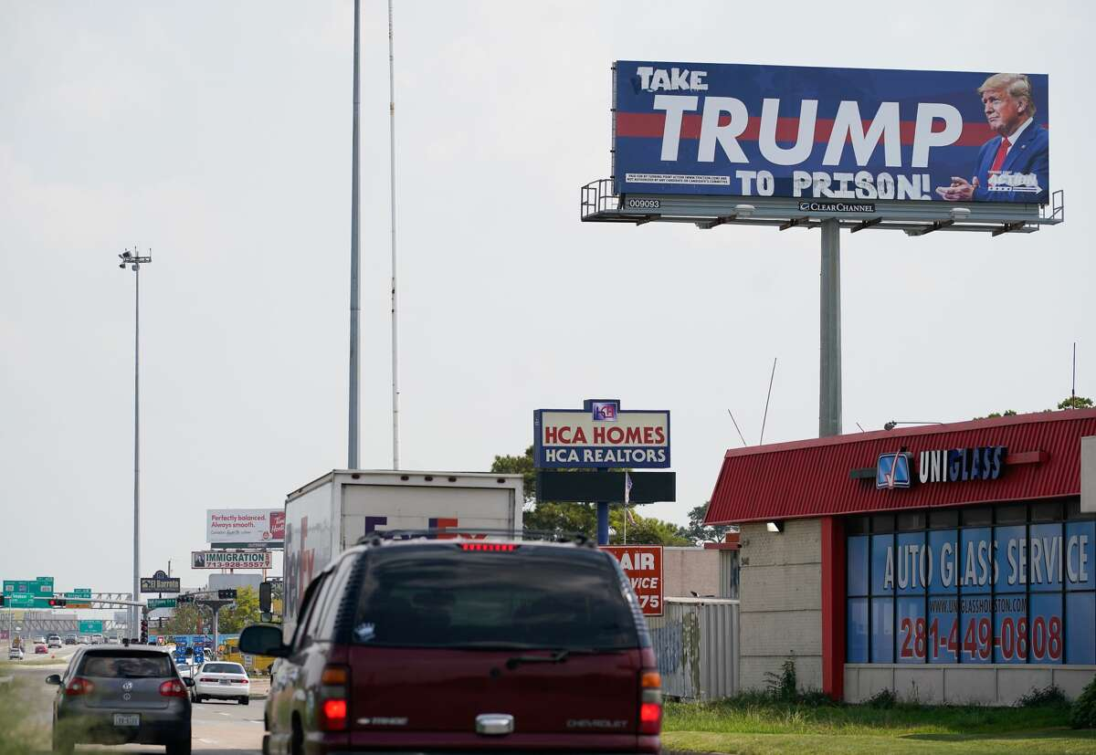 A Trump billboard is shown vandalized along I-45 southbound near Telephone Road Tuesday, October 13, 2020 in Houston.